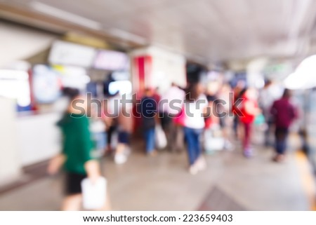 Abstract blurred people walking or standing in train station - stock photo