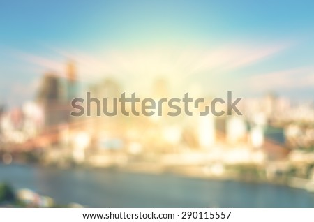 abstract Blurred photo of cityscape with sun background, blur backgrounds concept. - stock photo