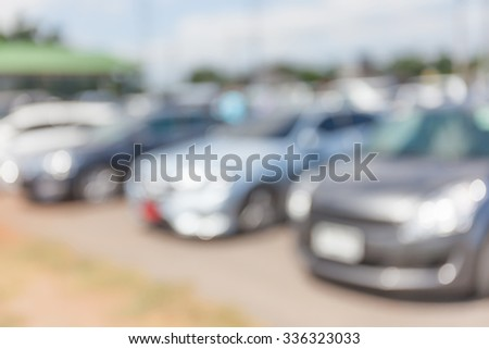 Abstract blurred photo of outdoor car park. - stock photo
