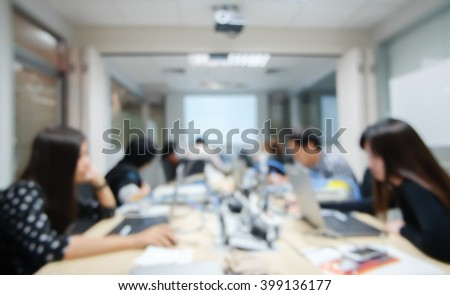 abstract blurred student thoughtful about programming system:blur people working/researching data information concept:blur group of computer/network engineering focus assignment at computer laptop. - stock photo