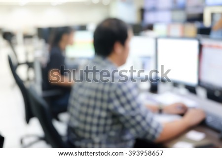 abstract blurred student  thoughtful about programming system classroom:blur people work research data information concept:blur group of computer network engineering focus assignment at computer - stock photo