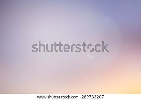 abstract blurred sunset/sunrise hour background with aura white flare light:blur of colorful nature backdrop concept:pastel color tone in golden hours evening sundown ideal conceptual:ethereal display - stock photo