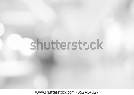 abstract blurred white/grey color corridor indoor office room background:blurry workplace backdrop concept:blur display with circle light:soft wallpaper with bokeh:glamorous elegant aura image ideal. - stock photo