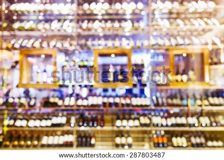 Abstract blurred wine cellar cabinet in luxury restaurant - stock photo