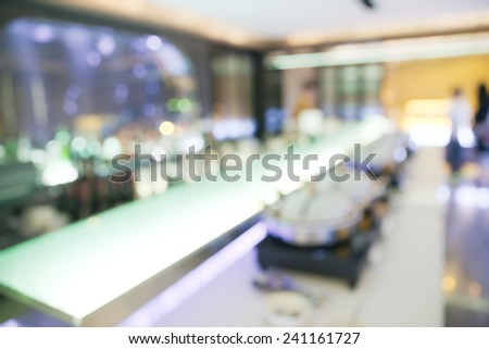Abstract blurry food and drink counter restaurant with blurry unrecognizable people - stock photo