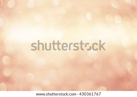 abstract blurry glitter sparkle golden flare light background:glamour banner template decorate design:beauty blend of cream orange gold color with shiny bronze metallic effect filter:elegant display - stock photo