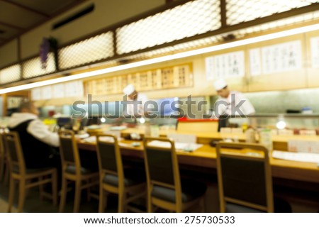 Abstract blurry image of sushi restaurant - stock photo