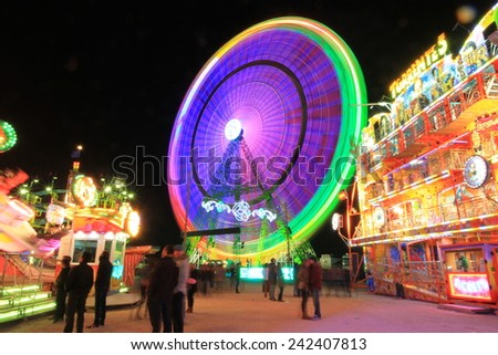 Abstract blurry light background with long exposure picture of a carrusel rotating during the christmas fair in Alicante, Spain - stock photo