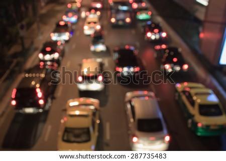 abstract blurry traffic jam night light - stock photo