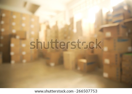 Abstract blurry warehouse storing a lot of stack of large box background - stock photo