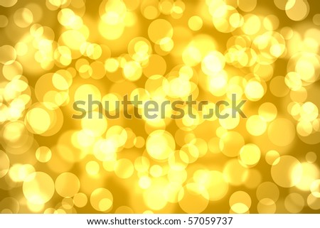 abstract bokeh lights on golden colored background - stock photo