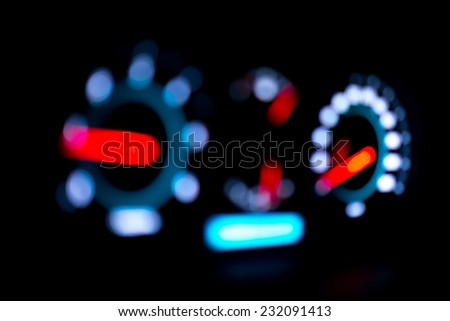 Abstract bokeh of car speed meter light. - stock photo