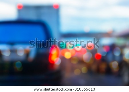 abstract bokeh of light, blurred defocused lights of cars in traffic jam on a wet rainy road backgrounds - stock photo