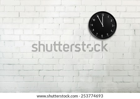 Abstract brick wall with office clock - stock photo