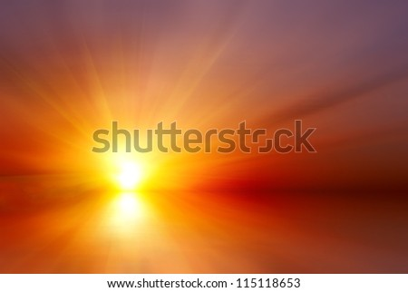 Abstract bright red sunset with sun rays - stock photo