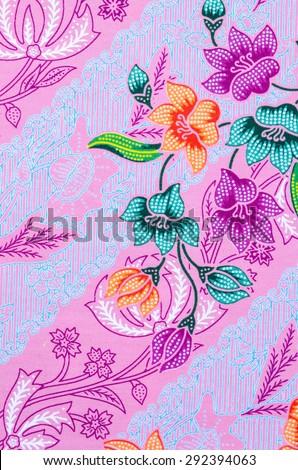 Abstract bright textile in batik's technique. - stock photo