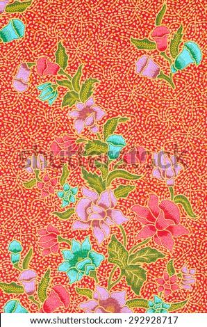 Abstract bright textile in batik's technique - stock photo