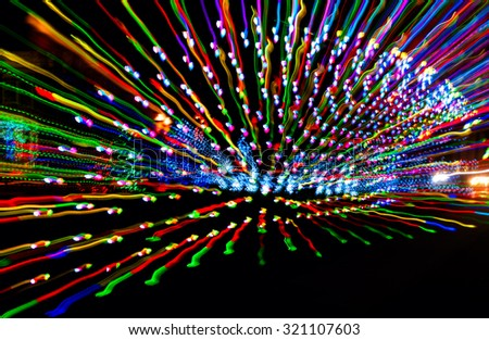 Abstract burst of Christmas lights achieved through quick lens zooming - stock photo
