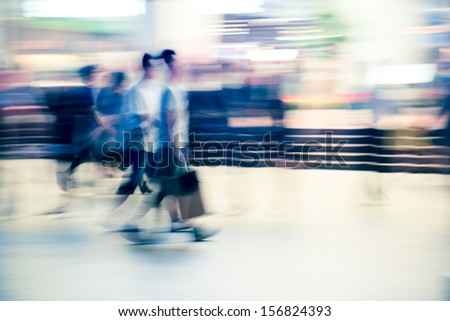 abstract business people walking on city street - stock photo