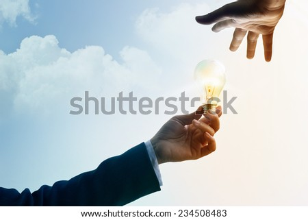 abstract, businessman share idea and inspiration, symbol light bulb concept - stock photo