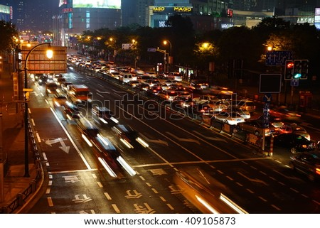 Abstract Car traffic at night. Motion blurred. Which urban city beautiful background. - stock photo