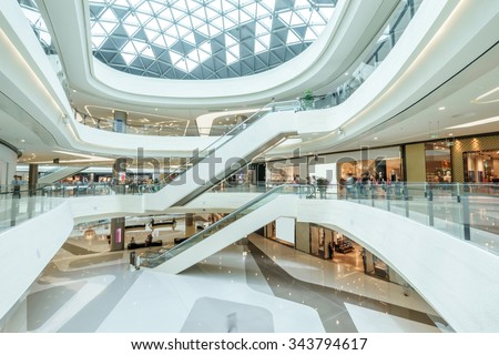 abstract ceiling and escalator in hall of shopping mall - stock photo