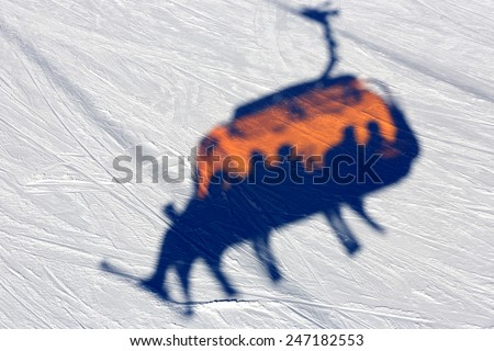 Abstract chairlift's shadow on snow - stock photo