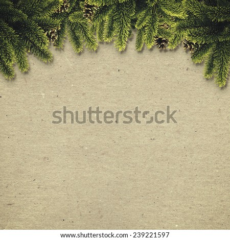 Abstract christmas backgrounds with noel decorations over old cardboard - stock photo