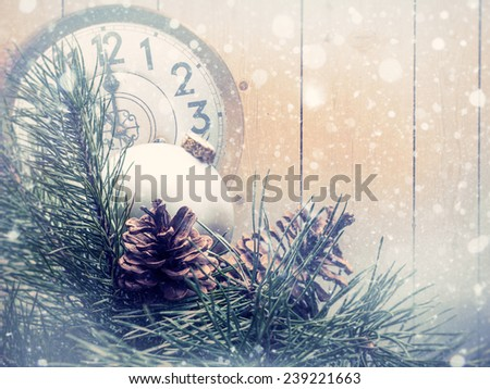 Abstract christmas backgrounds with xmas decorations, old watches and wooden desk - stock photo