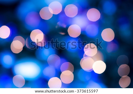 Abstract circular bokeh circles defocused bokeh lights facula background for Christmas background colors or photo composit. - stock photo