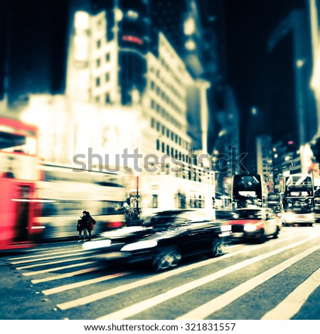 Abstract cityscape blurred background, art toning. Night view of modern city street with moving transport and illuminated skyscrapers. Hong Kong - stock photo