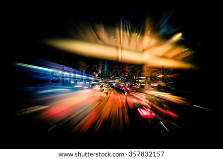 Abstract cityscape traffic background with motion blur, art toning. Moving through modern city street with  illuminated skyscrapers. Hong Kong - stock photo