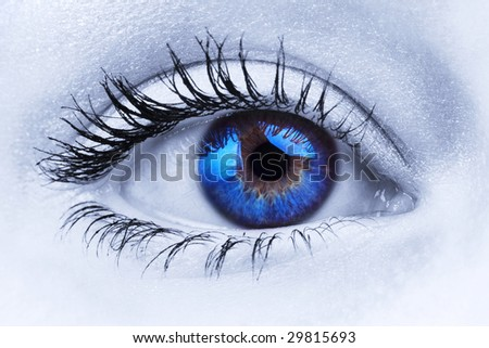 Abstract close up shot of a woman's blue eye - stock photo