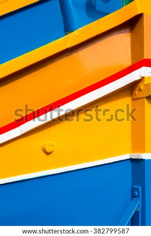 """Abstract close up view of the vibrant colours and design usually used on the traditional Maltese fishing boat, the """"Dghajsa"""" or """"Luzzu"""". - stock photo"""