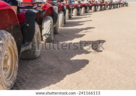 Abstract closeup detail of tyres on ATV quad bikes in a row - stock photo