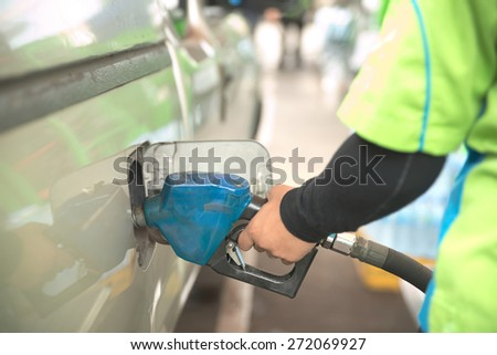 Abstract closeup of truck getting refuel in gas station - stock photo