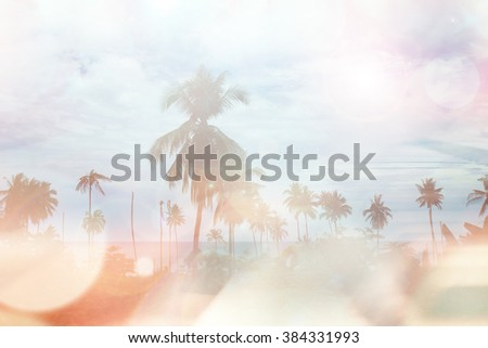 Abstract coconut palm tree in island with bokeh and flare light, blur background.  - stock photo