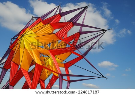 Abstract, color full kite in a blue sky - stock photo