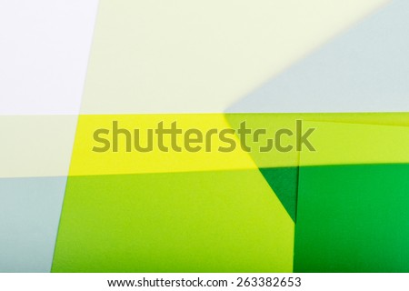 Abstract color paper background in green tones.  - stock photo