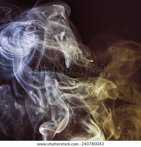 Abstract color smoke on a dark background. - stock photo