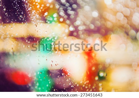 Abstract colorful blurred blurry background, warm colors tones, cinematic bokeh effect, water drops on the window - stock photo