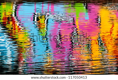 Abstract colorful graffiti reflection in the river water - stock photo