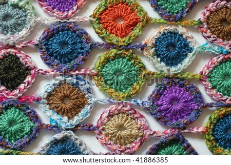 Abstract colorful texture knitted by a hook - stock photo