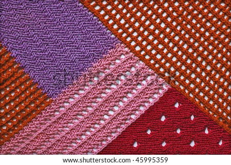 Abstract colorful texture knitted by spokes - stock photo