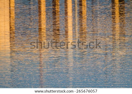 Abstract colorful water reflections of orange and blue - stock photo