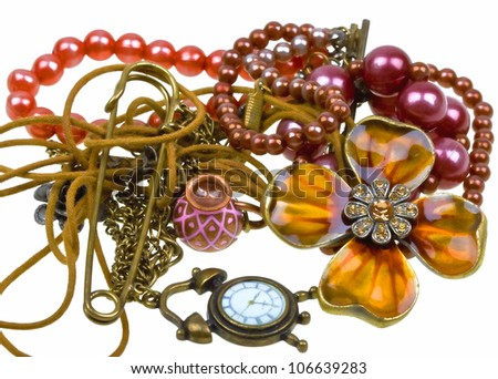 Abstract composition of vintage embelishments: string of beads, chain, pendant, watch  isolated on white background - stock photo