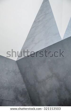 Abstract concrete wall. interior with chaotic polygonal relief pattern on the wall - stock photo