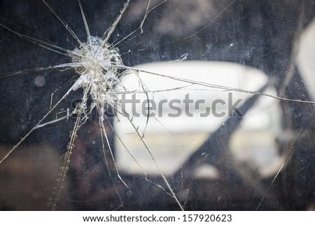 Abstract Cracked Window Glass on Antique Truck with Selective Focus.  - stock photo