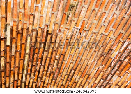 Abstract, creative gloomy textured ceiling of an old building, masonry brick red - stock photo