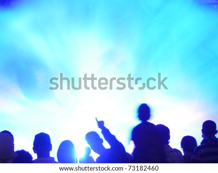 Abstract crowd of people watching light show - stock photo